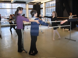 Yuka Kawazu corrects a young dancer in her ballet class
