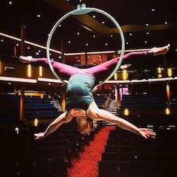 Nikki Croker performing an ariel skill on board the Quantum of the Seas: Royal Caribbean. Photo courtesy of Nikki Croker.