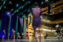 Dancers on stage at an EDT event. Photo by Herber Pelayo.