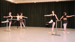Towson University dance majors use rotator discs at the ballet barre to enhance turnout. Photo by David Merino.