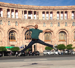 Danté Brown, a dancer for David Dorfman Dance, taken in the main square in Yerevan, Armenia during the David Dorfman Dance residency in May, 2014, for DanceMotion USA. Photo courtesy of David Dorfman Dance.