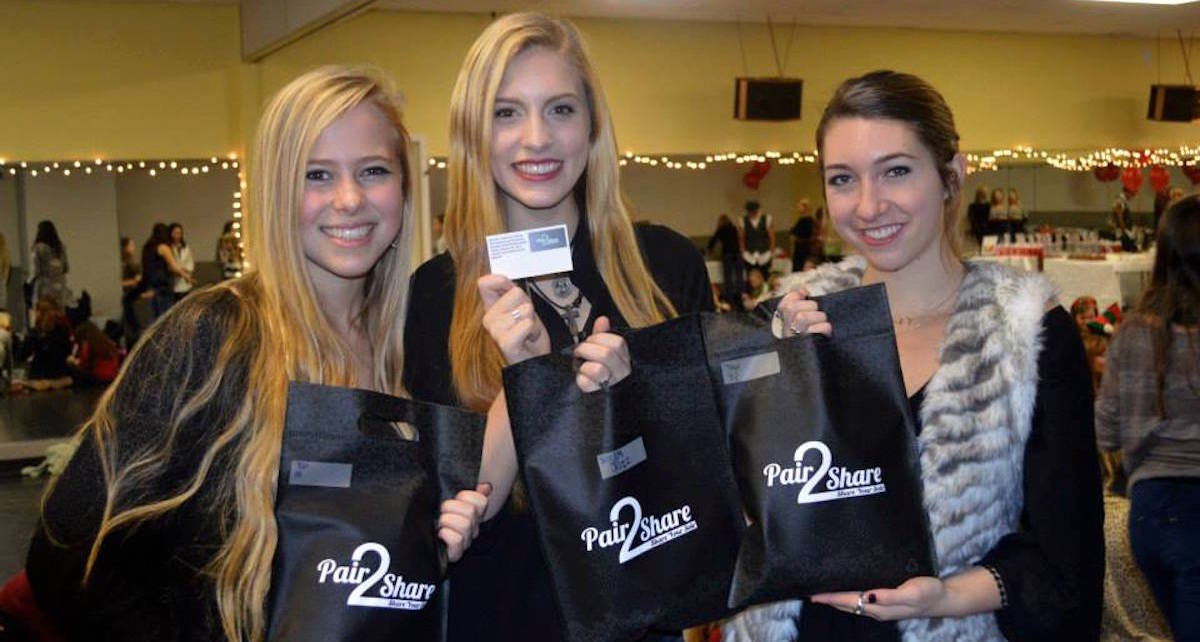 Juliana (left) Meriah (middle) Mekayla (right) at Pair2Share holiday event where Footnotes Dance Studio students bagged and added notes to shoes. Photo courtesy of Pair2Share.