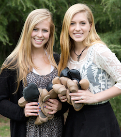 Juliana (left) and Meriah (right) in a photo shoot for The Spark book. Photo courtesy of Pair2Share.