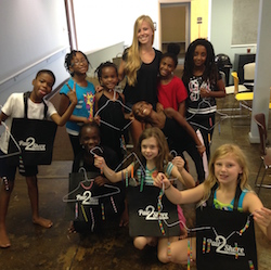 Juliana with Moving in the Spirit students and tap shoe wind chimes. Phtoo courtesy of Pair2Share.