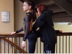 Dale Lam getting student Camille ready for her solo. Photo courtesy of Lam