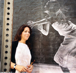 Stephanie Berger in front of her photo installation, Dancing in the Streets, at the LOOK3 Photo Festival, 2013. Photo courtesy of Berger.