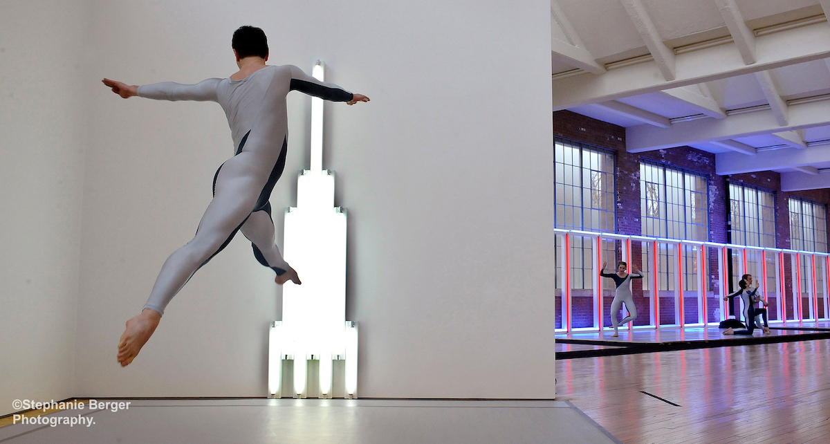 Brandon Collwes (jumping) of the Merce Cunningham Dance Company performs Beacon Event (2009) at Dia:Beacon in Beacon, NY. Photo by Stephanie Berger.