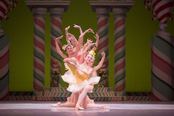 Pacific Northwest Ballet corps de ballet dancer Amanda Clark (front) with company dancers in a scene from George Balanchine's 'The Nutcracker'. Photo by Angela Sterling.