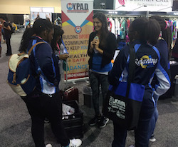 Leslie Scott working the YPAD booth at a UDMA show.