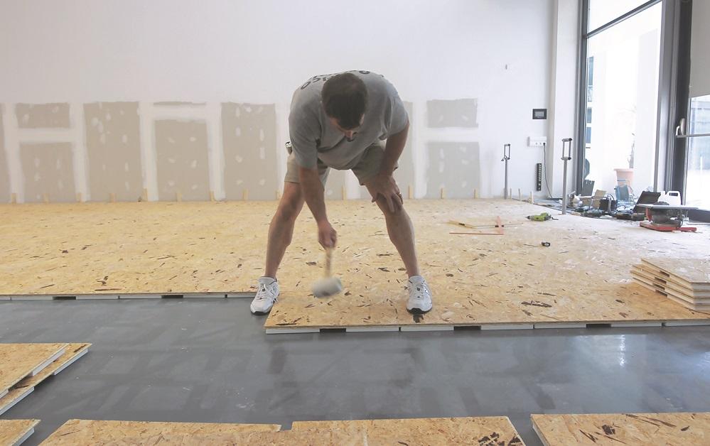 "Stagestep ""Springstep"" sub floor being installed."