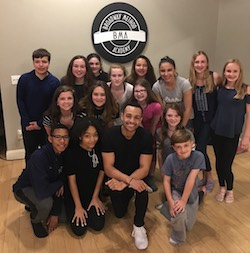 Noah Ricketts (kneeling center) teaching musical theatre to the students of Broadway Method Academy in Connecticut