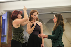 Heather Bryce (right) directing dancers. Photo by Art Heffron.