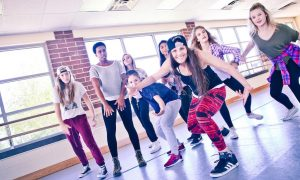 Leslie Scott with student dancers. Photo courtesy of YPAD.