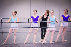 Misty Lown at the ballet barre with students. Photo courtesy of Lown.