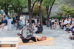 Alice Sheppard dancing in the park. Photo by Gim Ik Hyun.
