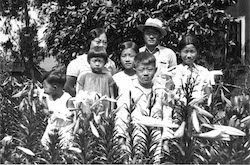 The Kang family pose on the Del Monte plantation where they worked. Photo courtesy of DTSBDC.