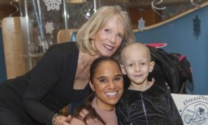 Susan Rizzo Vincent and Misty Copeland with a patient. Photo courtesy of Rizzo Vincent.