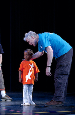 Jacques d'Amboise rehearses a young student before the 2004 Event of the Year, NDI's annual performance starring the children. Photo courtesy of NDI.