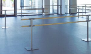 A dance studio with ballet barres.